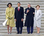 Washington, DC - January 20, 2009 -- Former United States President George W. Bush (2-R) waves as he and his wife Laura (r) stand with President Barack Obama (2-L) and First Lady Michelle Obama (L) as Bush departs from the U.S. Capitol after Obama's swearing in as the 44th President of the United States during the 56th Presidential Inauguration ceremony in Washington, D.C., USA 20 January 2009..Credit: Tannen Maury - Pool via CNP