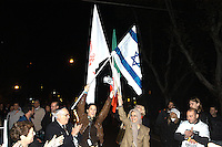 "Roma 3 Novembre 2005.Fiaccolata, davanti all'ambasciata iraniana di Roma, per diritto d'Israele all'esistenza, alla sicurezza e alla pace, contro le dichiarazioni antisemite del presidente iraniano Mahmoud Ahmadinejad, organizzata dal quotidiano ""Il Foglio""  diretto da Giuliano Ferrara..Rome, November 3, 2005.Torchlight procession, in front of the Iranian Embassy in Rome, to the right of Israel to exist, for security and peace, against anti-Semitic statements by Iranian President Mahmoud Ahmadinejad organized by the newspaper ""Il Foglio"" directed by Giuliano Ferrara. The israeli flag with the flag of the People's Mujahedeen, the Iranian Resistance"
