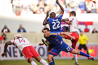 Shane O'Neill (27) of the Colorado Rapids can only watch as Thierry Henry (14) of the New York Red Bulls scores off a header. The New York Red Bulls and the Colorado Rapids played to a 1-1 tie during a Major League Soccer (MLS) match at Red Bull Arena in Harrison, NJ, on March 15, 2014.