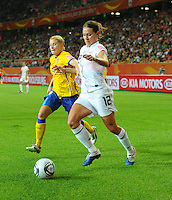 Lauren Cheney (r) of team USA and Annica Svensson of team Sweden during the FIFA Women's World Cup at the FIFA Stadium in Wolfsburg, Germany on July 6thd, 2011.