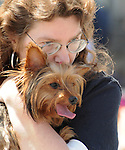 A woman and her dog watching the Saugerties July 4th Parade on Main Street in Saugerties, NY on Monday, July 4, 2011. Photo by Jim Peppler. Copyright © Jim Peppler 2011.