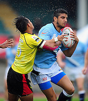 Rogelio Sanchez of Argentina is tackled. FISU World University Championship Rugby Sevens Men's 7th/8th/9th place play-off between Malaysia and Argentina on July 9, 2016 at the Swansea University International Sports Village in Swansea, Wales. Photo by: Patrick Khachfe / Onside Images