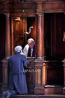 Pope Francis gives confession during the penitential celebration in St. Peter's Basilica at the Vatican, on March 13, 2015.
