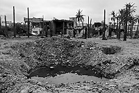 Baghdad, Iraq, April 13, 2003.An Iraqi Army truck full of 155mm shells was bombed a few days ago by US planes, resulting in a devastating explosion in a populated area...