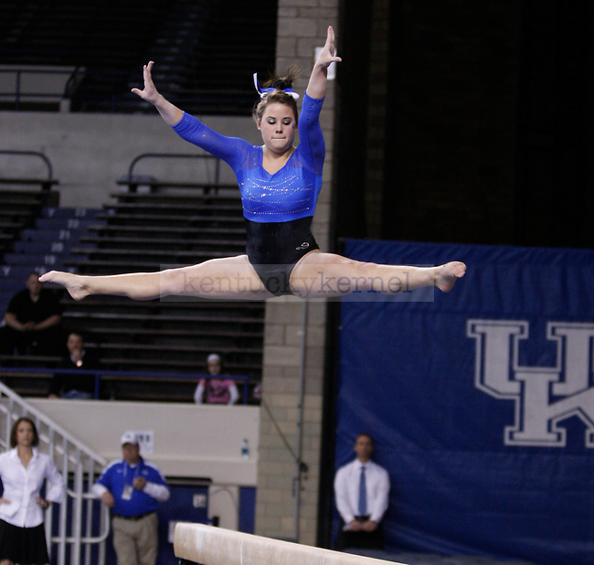 Sophomore Audrey Harrison performs on the balance beam during the University of Kentucky gymnastics meet against the University of Alabama, in Memorial Coliseum, on Friday, Feb. 10, 2012. Photo by Latara Appleby | Staff ..