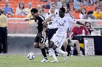 D.C. United forward Dwayne De Rosario (7) goes against Vancouver Whitecaps FC midfielder Gershon Koffie (28). D.C. United defeated The Vancouver Whitecaps FC 4-0 at RFK Stadium, Saturday August 13 , 2011.