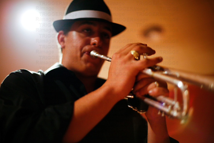 Trumpetist playing during a wedding reception, Seville, Spain