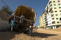 Gaza city, Palestine.  Children play in a destroyed military truck in the Tal Al Hawa neighborgood in Gaza city days after the end of Operation Cast Lead. Tensions spiraled  since Israel pulled its troops out of Gaza, ending the devastating military campaign. The conflict resulted in between 1,166 and 1,417 Palestinian and 13 Israeli deaths (4 from friendly fire).                    (PHOTO: MIGUEL JUAREZ LUGO).
