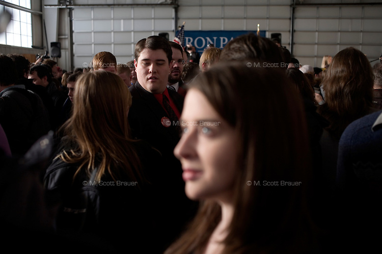 People stand in a hangar after a Ron Paul rally at Jet Aviation in Nashua, New Hampshire, on Jan. 6, 2012.  Paul is seeking the 2012 GOP Republican presidential nomination.