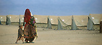 An Afghan refugee mother and children pass through a refugee camp on the border with Pakistan near Chaman.