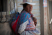 The women of the Colca Valley spend much of their time time walking back and forth from home to work. As they have very limited resources, they carry heavy bags with them, lugging around what they need for the day.