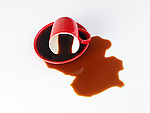 Spilled red coffee cup isolated on white background