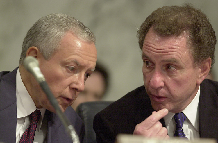 Specter A.4(DG) 062700 --  Chairman Orrin G. Hatch, R-Utah, and Arlen Specter, R-Pa., talk during the Campaign Finance Investigations Hearing.