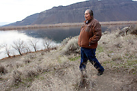 """Rex Buck Jr., leader of the Wanapum Indians, walks along the banks of the Columbia River just south of the Wanapum Dam on February 3, 2011.  """"The river flows in us and we're a part of the river and we're also a part of this land.""""  said Buck.  The Wanapum Indians had never moved onto a reservation but negotiated peacefully with a power company to remain on their land.  (photo credit Karen Ducey)"""