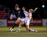 Julia Roberts (8) of Virginia steps away from the tackle of Marisa Kresge (6) of Maryland during the game in College Park, MD.  Maryland defeated Virginia, 3-1.