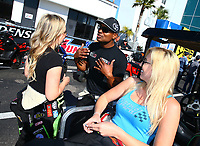 Mar 19, 2017; Gainesville , FL, USA; NHRA top fuel driver Antron Brown (center) talks with Brittany Force and Courtney Force during the Gatornationals at Gainesville Raceway. Mandatory Credit: Mark J. Rebilas-USA TODAY Sports
