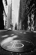 New York City, Wall Street Area, Oct 1966: Dollar sign on manholes symbolizing the economic status after Black Monday, when stock markets around the world crashed.