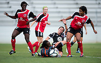 Holly King (16) of the D.C. United Women collides with Marbel Egwuenu (0) of the Virginia Beach Piranhas as teammates Melanie Adams-Cobb (22) and Victoria Johnson (26) stand by during the game at the Maryland SoccerPlex in Boyds, Maryland.  The D.C. United Women defeated the Virginia Beach Piranhas, 3-0, to advance to the W-League Eastern Conference Championship.