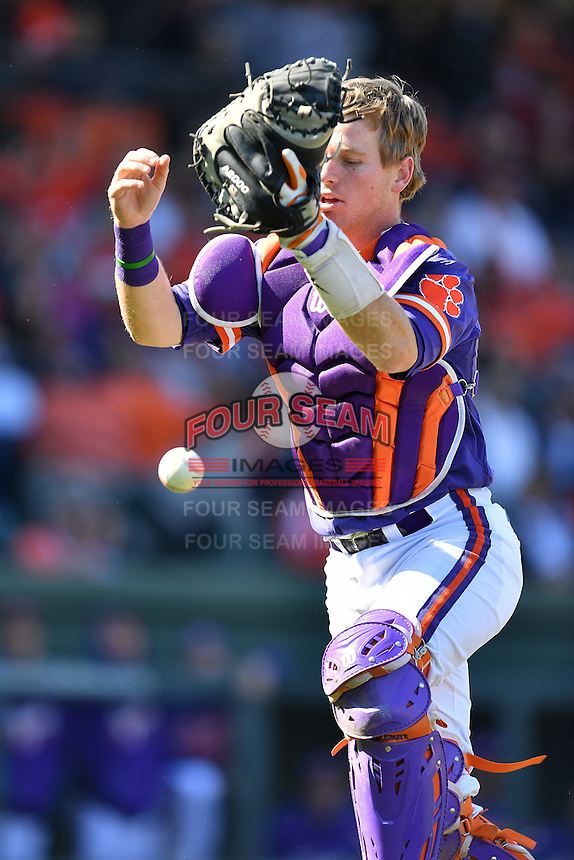 Catcher Robert Jolly (12) of the Clemson Tigers drops a popup in the Reedy River Rivalry game against the South Carolina Gamecocks on Saturday, March 4, 2017, at Fluor Field at the West End in Greenville, South Carolina. Clemson won, 8-7. (Tom Priddy/Four Seam Images)