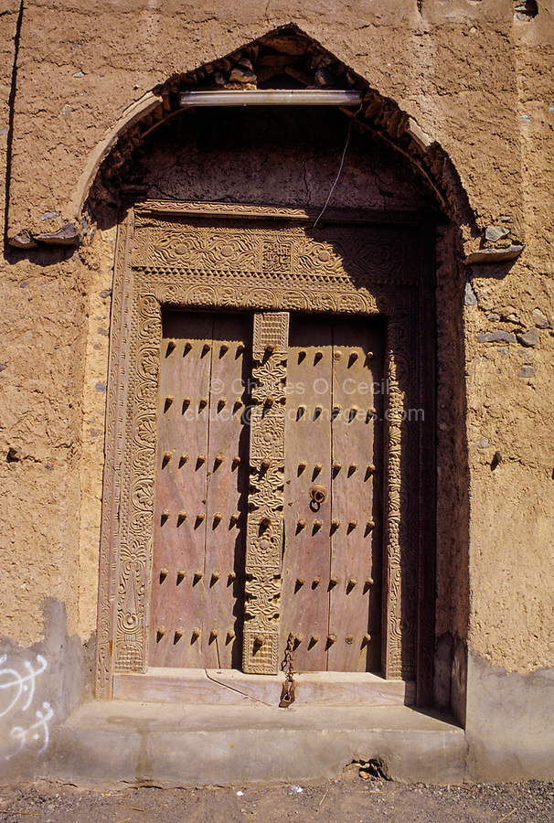 "Mudhaireb (Mudayrib), Oman.  Old Door, Carved in Zanzibar, dated 1208 A.H., equals 1793 A.D.  ""God is the Best Protection"" carved in Arabic above the door."