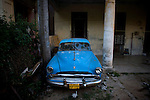 bright blue parked chevy in cuba