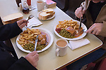 Steak and Kidney pie, chips and mushy peas mugs of tea. Lunch. Regency Caf&eacute; Westminster London SW1 UK.