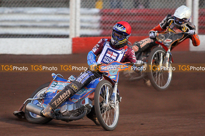 Heat 12: D Davidsson (red) and Klindt - Lakeside Hammers vs Wolverhampton Wolves - Sky Sports Elite League Speedway at Arena Essex Raceway, Purfleet - 24/05/10 - MANDATORY CREDIT: Gavin Ellis/TGSPHOTO - Self billing applies where appropriate - Tel: 0845 094 6026