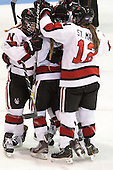 Casey Pickett (NU - 14), Tori Hickel (NU - 55), Sonia St. Martin (NU - 12) - The Northeastern University Huskies defeated Boston College Eagles 4-3 to repeat as Beanpot champions on Tuesday, February 12, 2013, at Matthews Arena in Boston, Massachusetts.