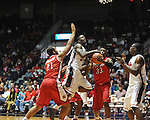 "Ole Miss' Murphy Holloway (31) is fouled vs. Rutgers at the C.M. ""Tad"" Smith Coliseum in Oxford, Miss. on Saturday, December 1, 2012. (AP Photo/Oxford Eagle, Bruce Newman).."