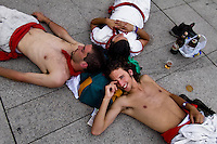 Young runners drinking beer during the San Fermín festival in Pamplona, Spain, 6 July 2005.