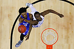 Kentucky Wildcats guard De'Aaron Fox puts up a layup over North Carolina Tar Heels forward Theo Pinson during the 2017 NCAA Men's Basketball Tournament South Regional Elite 8 at FedExForum in Memphis, TN on Friday March 24, 2017. Photo by Michael Reaves | Staff