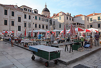 Market on Gunduliceva Poljana Square, in the Old Town of Dubrovnik, Croatia. In the centre of the square is a monument to the poet Ivan Gundulic. The city developed as an important port in the 15th and 16th centuries and has had a multicultural history, allied to the Romans, Ostrogoths, Byzantines, Ancona, Hungary and the Ottomans. In 1979 the city was listed as a UNESCO World Heritage Site. Picture by Manuel Cohen