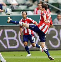 Chivas USA midfielder Sacha Kljestan (16) reaches for a ball. Chivas USA defeated the Red Bulls of New York 2-0 at Home Depot Center stadium in Carson, California April 10, 2010.  .