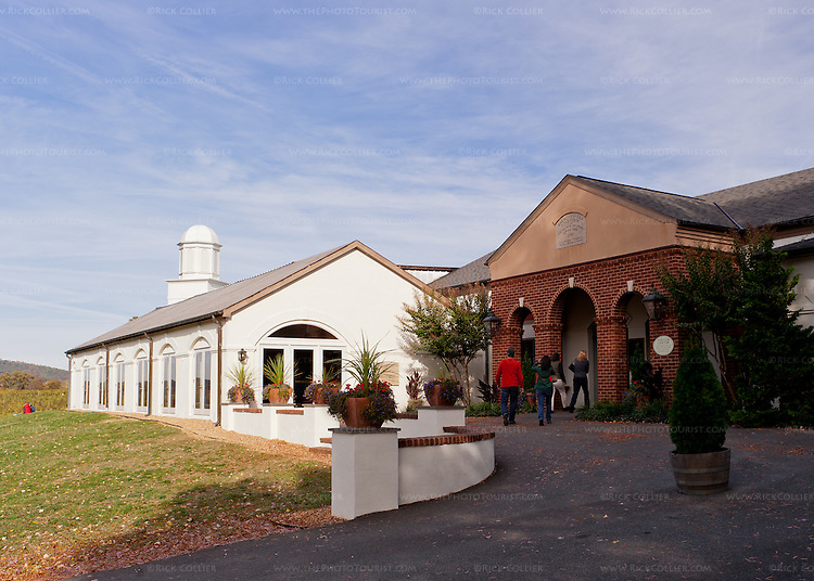 Brick arches lead to the tasting room, which shares a patio entrance area with adjoining events facility, winery, and restaurant at Barboursville Vineyards.