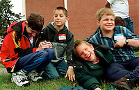 Stefen Hudson,(left) age 14, and his family  moved  to Vancouver  from Seattle so he could attend the WA State School for the Blind.  His best friend is Vaughn Brown (second from left),11, the only other deaf-blind student at the school.  Many parents send their children to the state deaf or blind residency schools to foster the child's social interaction within the deaf or blind cultures.