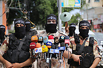 Members of al-Mujahideen brigades, the military wing of al-Mujahideen movement, attend a press conference, in Gaza city on April 24, 2017. Photo by Mohammed Asad