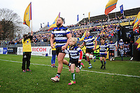 Max Lahiff of Bath Rugby, mascot in hand, runs out onto the field. Aviva Premiership match, between Bath Rugby and Saracens on December 3, 2016 at the Recreation Ground in Bath, England. Photo by: Patrick Khachfe / Onside Images