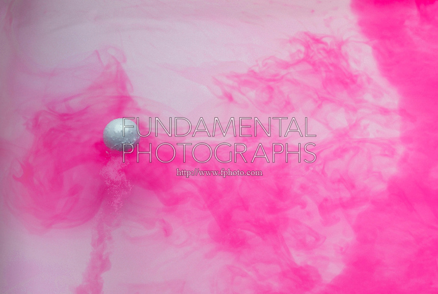SODIUM IN WATER<br /> Hydrogen Gas and Sodium Hydroxide Are Formed<br /> The pink color is due to the presence of phenolphthalein indicator which changes color from the sodium hydroxide.