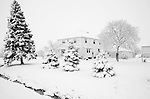 A old farmhouse in a snow storm
