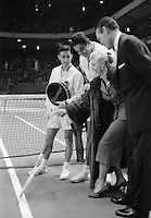 Hollywood film star Ginger Rogers on court with Australian tennis player Ken Rosewall (L), American Pancho Gonzales and Jack Kramer (R). Madison Square Garden, New York, 1957. Photograph by John G. Zimmerman.