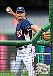 30 September 2009: Syracuse Chiefs' Manager Tim Foli, called up to the Washington Nationals for September, tosses batting practice prior to a game against the New York Mets at Nationals Park in Washington, DC. The Nationals rallied in the bottom of the 9th inning with a Justin Maxwell walk-off Grand Slam to win 7-4 and sweep the Mets to cap the final game of the Nationals' home season. Mandatory Credit: Ed Wolfstein Photo