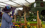 A lady looks at the Birmingham City Council display in the Great Pavilion at the RHS Chelsea Flower Show in London