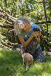 Margit Cianelli wildlife carer and real life Doctor Doolittle takes care of a Herbert Ringtail Possum baby and an agile wallaby. This possum species is the icon symbol of the Queensland Parks and Wildlife Service.
