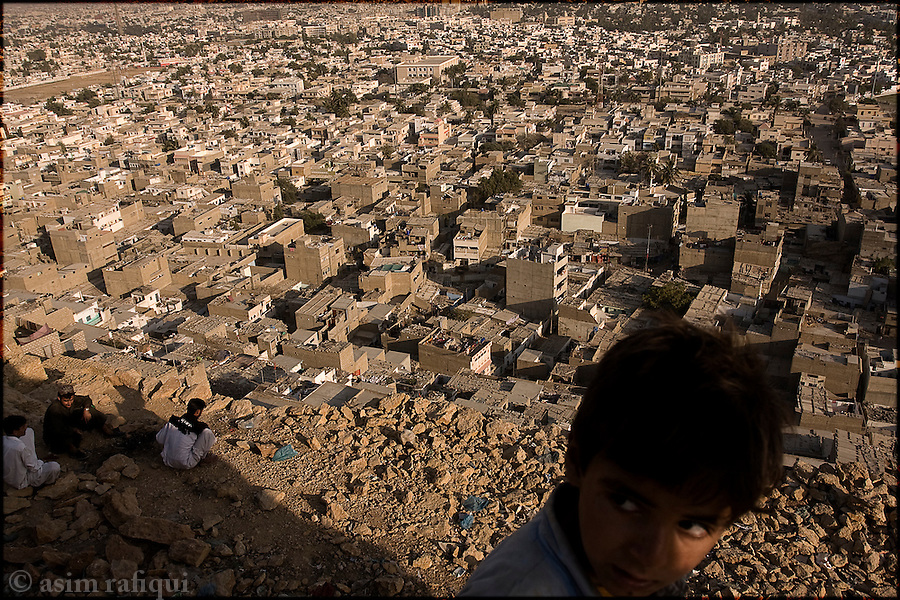 a view of the karachi slum of orangi town - orangi is believed to be the largest slum area in asia