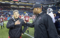 SEATTLE, WA - September 28, 2013: Washington State head coach Mike Leach, left, and meet on the field following a game at CenturyLink Field. Stanford won 55-17
