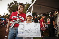 Stanford, Ca - October 8, 2016: Fans show off their collection of Olympians' autographs during Fan Fest before the Stanford vs. Washington State game Saturday night at Stanford Stadium. <br /> <br /> Washington State won 42-16.