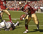 San Francisco 49ers running back Kevan Barlow (32) leaps past Arizona Cardinals linebacker Ronald McKinnon (57) to make touchdown on Sunday, October 27, 2002, in San Francisco, California. The 49ers defeated the Cardinals 38-28.