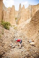 Boy (6 years) exploring the Clay Cliffs near Omarama, Canterbury, New Zealand - stock photo, canvas, fine art print