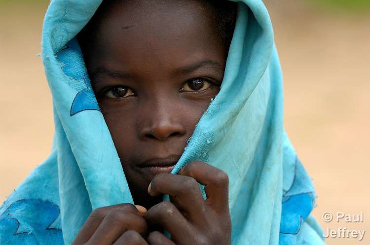 A girl in Geles, an Arab village in Darfur, the violence-torn western region of Sudan. War have plagued this region since 2003, when the Arab government responded to insurgent attacks by pushing proxy Arab militias to attack African farming villages. Some 400,000 people have died and more than 2.5 million displaced.