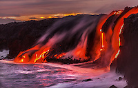 New land is created as lava enters the ocean near Kalapana on the Big Island of Hawai'i.